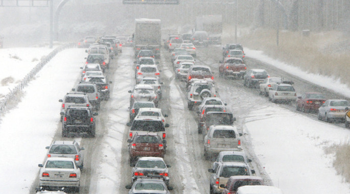 Commuters on Interstate 215 near Parleys Canyon sit in stalled traffic during the morning snow storm in Salt Lake County, Tuesday, Dec. 8, 2009. The Utah Highway Patrol said there were 76 accidents involving property damage in Salt Lake and Utah counties between midnight and 10 a.m. The storm is very similar to those that kicked off the winter season in 2008 and 2007 in the second week of December and lasted for several weeks. (AP Photo/Deseret News, Jeffrey D. Allred) SALT LAKE TRIBUNE OUT. PROVO DAILY HEARD OUT. MAGS OUT. NO SALES.